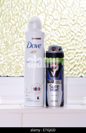 Male and Females Anti Perspirant Sprays . Dove and Sure Products - Stock Photo