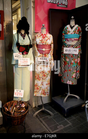 Shop, mall. Yukata, kimono, traditional women dress. Geta, wooden sandals on sale. Teramachi shopping arcade, Kyoto, - Stock Photo