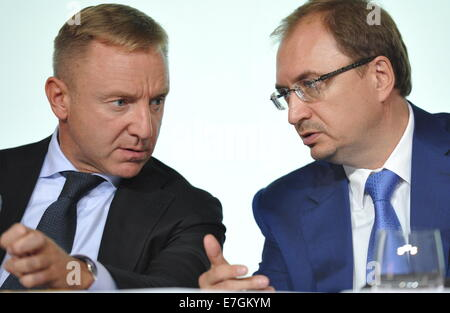 ITAR-TASS: ST. PETERSBURG, RUSSIA. SEPTEMBER 17, 2014. Russia's Education and Science Minister Dmitry Livanov (L) - Stock Photo