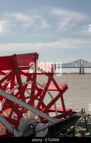 Looking at red paddlewheel and back at the Crescent City Connection bridge, the farthest downstream bridge on Mississippi - Stock Photo