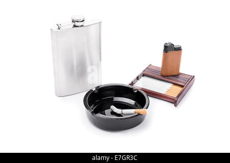 Flask, ashtray, some cigarettes and lighter on a cigarette case isolated on white background - Stock Photo