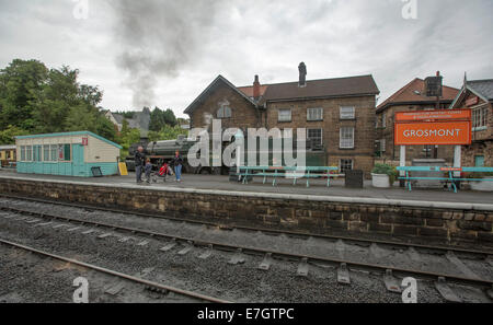 Steam train and historic locomotive at Grosmont railway station on regular service from Pickering to Whitby, England - Stock Photo