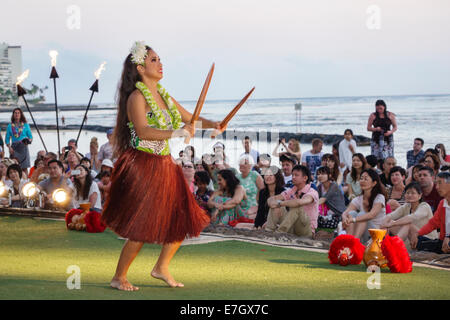 Hawaii Hawaiian Honolulu Waikiki Beach Kuhio Beach Park Hyatt Regency Hula Show woman dancing dancer dance audience - Stock Photo
