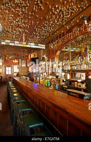 Inside a Saloon bar in an old western town the barkeep is ...