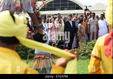 New Dehli, India. 17th Sep, 2014. Chinese President Xi Jinping and his wife Peng Liyuan are greeted by Indian youths - Stock Photo