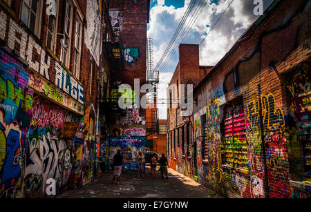 Sunny summer day in the Graffiti Alley, Baltimore, Maryland. - Stock Photo