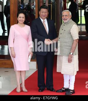 New Dehli, India. 17th Sep, 2014. Chinese President Xi Jinping (C) meets with Indian Prime Minister Narendra Modi - Stock Photo