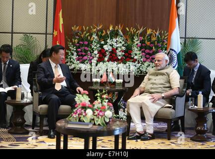 New Dehli, India. 17th Sep, 2014. Chinese President Xi Jinping (L) meets with Indian Prime Minister Narendra Modi - Stock Photo