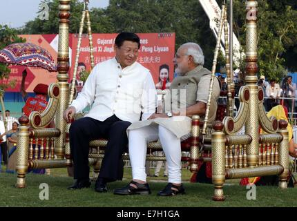 New Dehli, India. 17th Sep, 2014. Chinese President Xi Jinping (L) talks with Indian Prime Minister Narendra Modi - Stock Photo