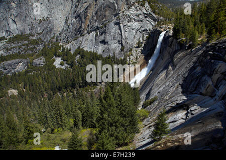 Merced River plunging over Nevada Fall, The Mist Trail, Yosemite National Park, California, USA - Stock Photo