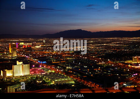 Night view Circus Circus Hotel and Casino (bottom left), Las Vegas, and mountains, from observation deck of Stratosphere - Stock Photo