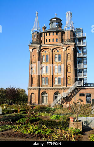 DORDRECHT, THE NETHERLANDS - OCTOBER 23, 2011: Old water tower, Villa Augustus Hotel with vegetable garden in the - Stock Photo