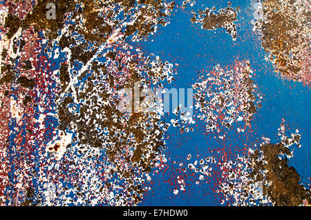 rust and erosion on painted metal with abstract patterns - Stock Photo