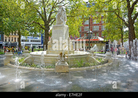 Leicester Square fountains and William Shakespeare statue in the refurbished gardens - Stock Photo