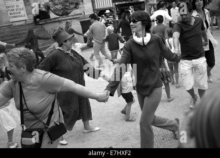 Dancing in the market square, Pont-l'Eveque, Normandy, France - Stock Photo