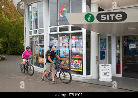 Tourist info site in Taupo North Island New Zealand. Cyclists on tour arriving for information - Stock Photo
