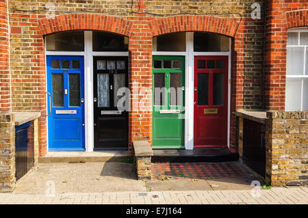Red, black, green and blue front door, London England United Kingdom UK - Stock Photo