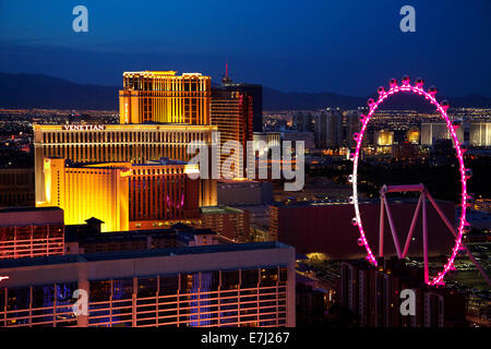 View of Las Vegas and High Roller giant ferris wheel at dusk, from Eiffel Tower replica at Paris Hotel and Casino, - Stock Photo