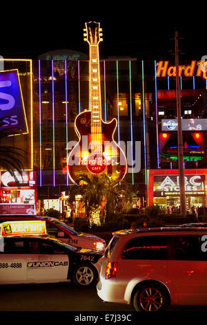 The Hard Rock Cafe and traffic along The Strip at night, Las Vegas, Nevada, USA - Stock Photo