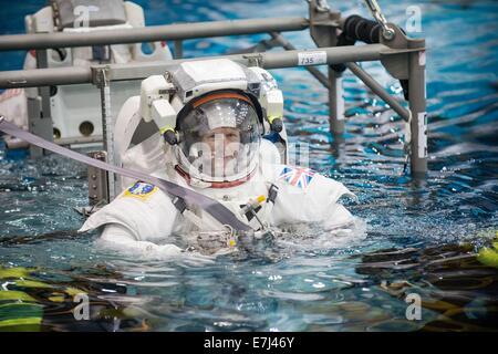 British astronaut Tim Peake of European Space Agency prepares to be submerged in the deep pool during International - Stock Photo