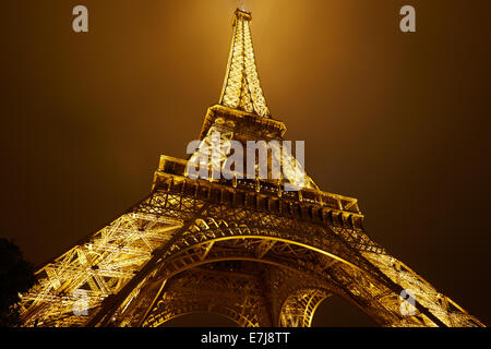 Eiffel tower in Paris at night - Stock Photo