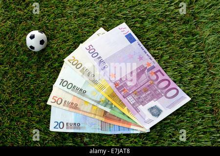 Euro notes, soccer balls - Stock Photo