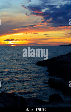 Sunset over the Adriatic Sea, Cape Kamenjak, Premantura, Istria, Croatia - Stock Photo