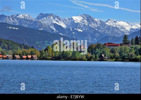 Snow-covered Oberstdorf Mountains behind Bühl am Alpsee with Alpsee lake, Upper Allgäu, Bavaria, Germany - Stock Photo