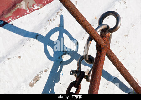 Rusted Anchor & Coble Boat Hull Cameo, Lindisfarne or Holy Island, Northumberland, England, UK - Stock Photo
