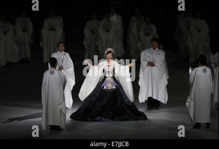 Incheon, South Korea. 19th Sep, 2014. South Korean soprano Sumi Jo (C) performs during the opening ceremony of the - Stock Photo