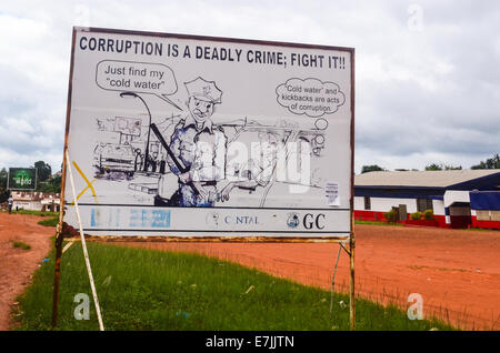 Road sign warning against corruption in Liberia, Africa - Stock Photo
