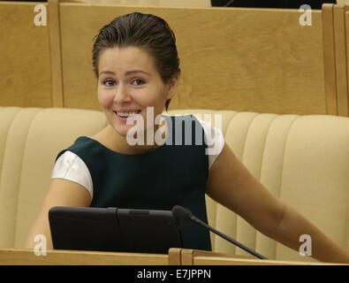 ITAR-TASS: MOSCOW, RUSSIA. SEPTEMBER 19, 2014. State Duma member Maria Kozhevnikova at a plenary meeting. (Photo - Stock Photo