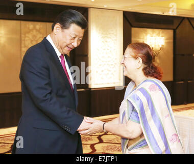 New Delhi, India. 19th Sep, 2014. Chinese President Xi Jinping (L) meets with Sumitra Mahajan, speaker of the Lok - Stock Photo