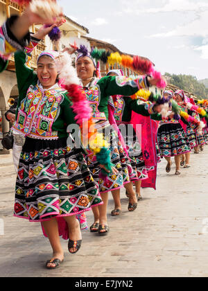 Quechua women dancing at the Cusco Week festivites held each year in June leading up to the Inti Raymi festival - Stock Photo