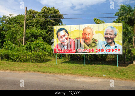 [Editorial Use Only] The portraits of Hugo Chávez, Fidel Castro and Nelson Mandela on a political billboard in Cuba - Stock Photo