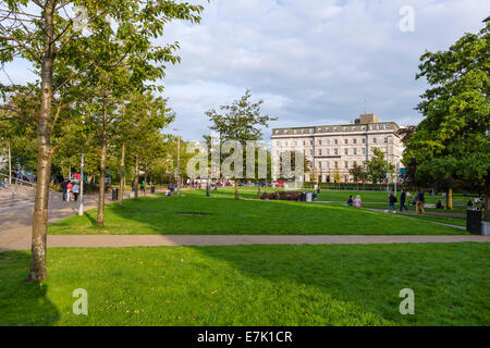 Early evening in Eyre Square looking towards the Hotel Meyrick, Galway City, County Galway, Republic of Ireland - Stock Photo
