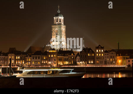 Illuminated skyline of the city of Deventer in the center of the Netherlands because of a special Charles Dickens - Stock Photo
