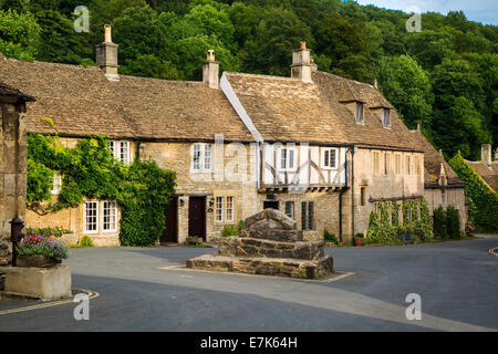 Homes and shops along the High Street, Castle Combe, the Cotswolds, Wiltshire, England - Stock Photo