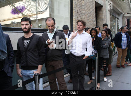 New York, New York, USA. 19th Sep, 2014. Crowds of people line up outside the Apple Store Soho to purchase the iPhone - Stock Photo