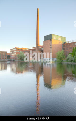 Landscape of an old brick factory and lake reflection at dusk in Tampere Finland - Stock Photo
