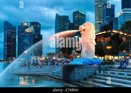 The Merlion of Singapore lit up in early evening. - Stock Photo
