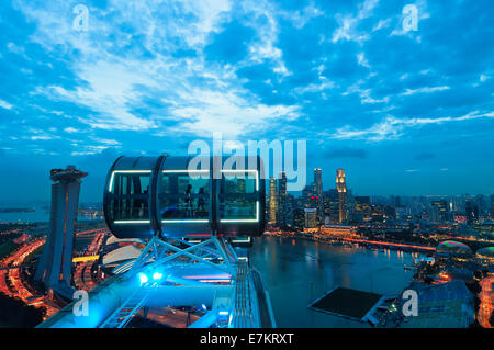 Looking out over Singapore at sunset from the Singapore Flyer. - Stock Photo