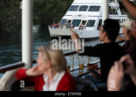 Cruise along the Victoria Falls aboard the ' African Queen'.  Other boats sailing in the Zambezi River. This is - Stock Photo