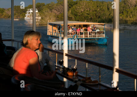 Cruise along the Victoria Falls aboard the 'Queen of Africa'.  Sunset cruises on the Zambezi River at Victoria falls - Stock Photo
