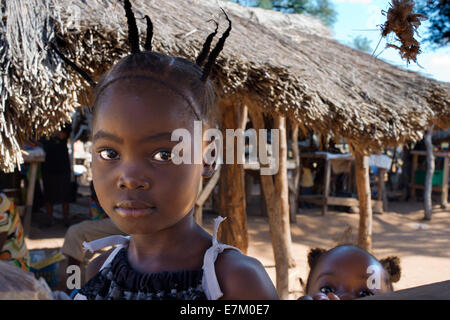 A girl with braids in Mukuni Village. Zabmia. The Mikuni Village is about 30 minutes from Livingstone, home to approximately - Stock Photo
