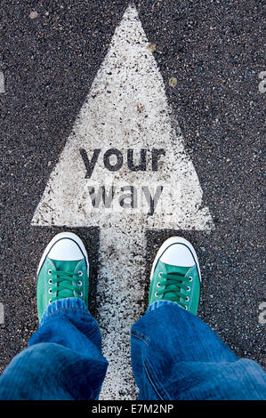Green shoes standing on your way sign - Stock Photo