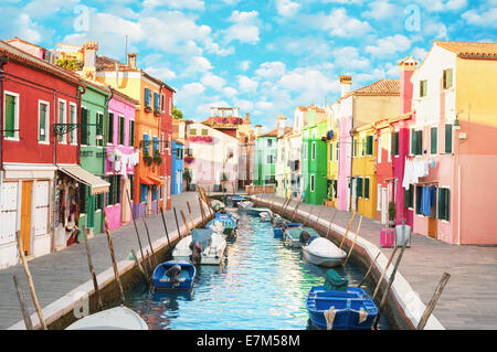 Narrow canal and colorful houses in Burano, Italy. - Stock Photo