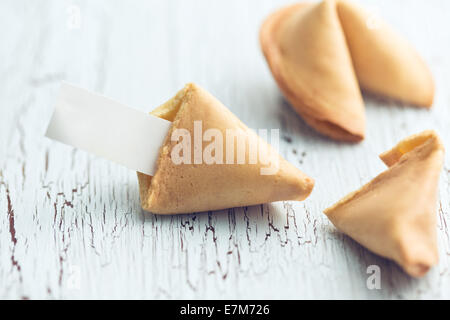 the fortune cookie on the cracked table - Stock Photo