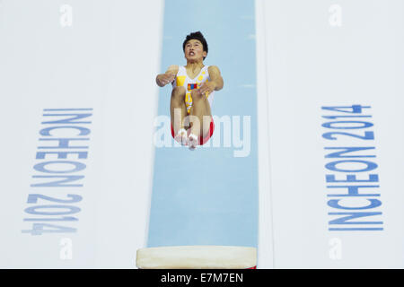 Incheon, South Korea. 21st Sep, 2014. Munkhtsog Ariunbulag of Mongolia competes during the vault of men's gymnastics - Stock Photo