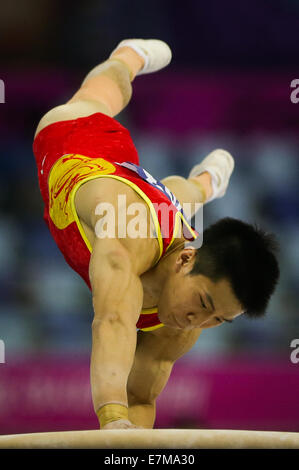 Incheon, South Korea. 21st Sep, 2014. Huang Yuguo of China competes during the vault of men's gymnastics artistic - Stock Photo